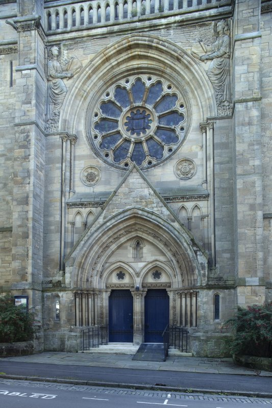 Main north west entrance with rose window and angels, view from west