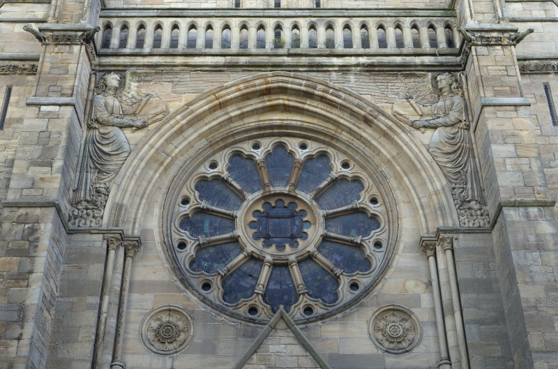 North west front, detail of rose window and carved angels