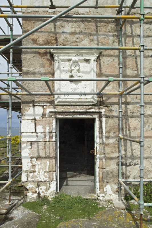 View of doorway with panel above on south face