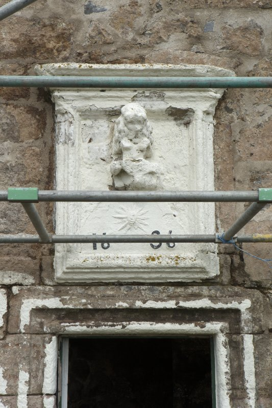 Detail of panel above doorway on south front