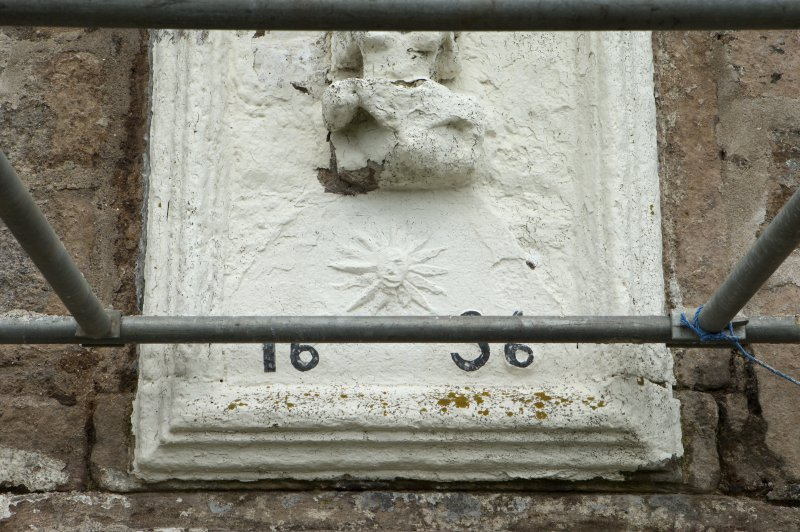 Detail of lower section of panel above doorway on south front