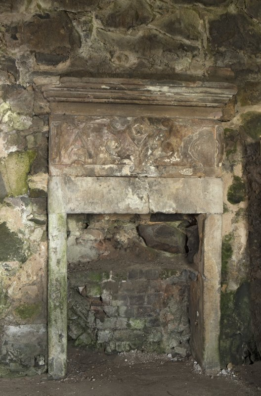 Vaulted room on ground floor, detail of fireplace on north wall