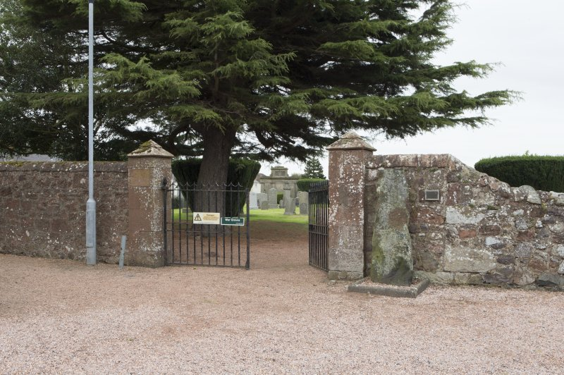 View of entrance to churchyard with Pictish symbol stone on right