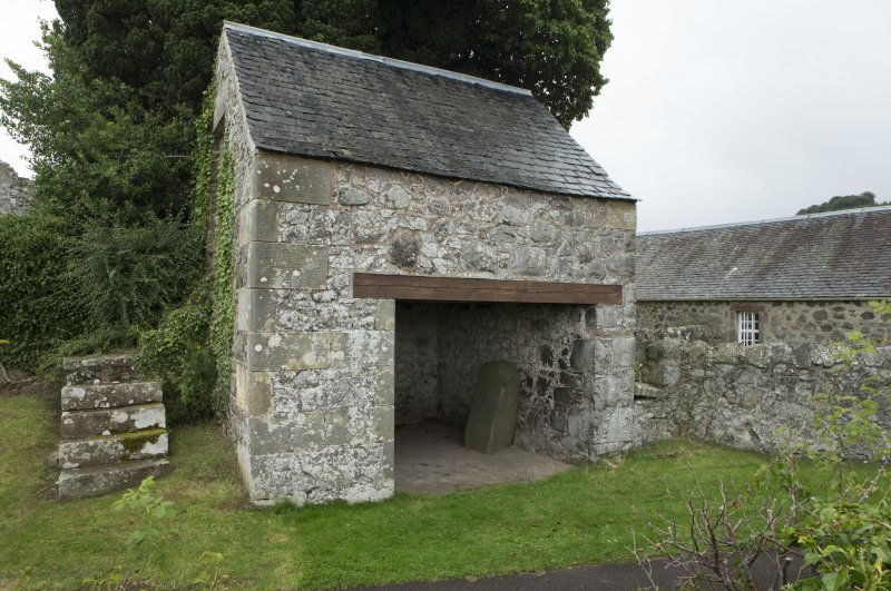 View of coach house containing carved stones