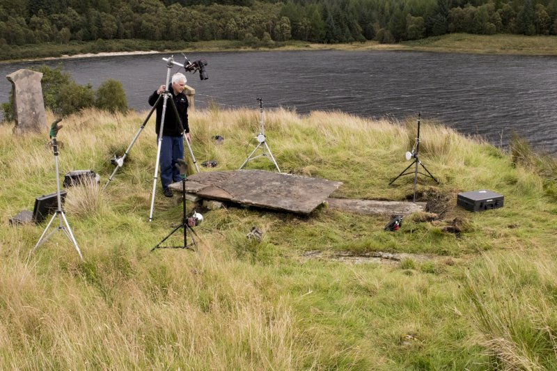 HES Photographer Steve Wallace recording a Macleod table tomb at Eilean Fhianain.