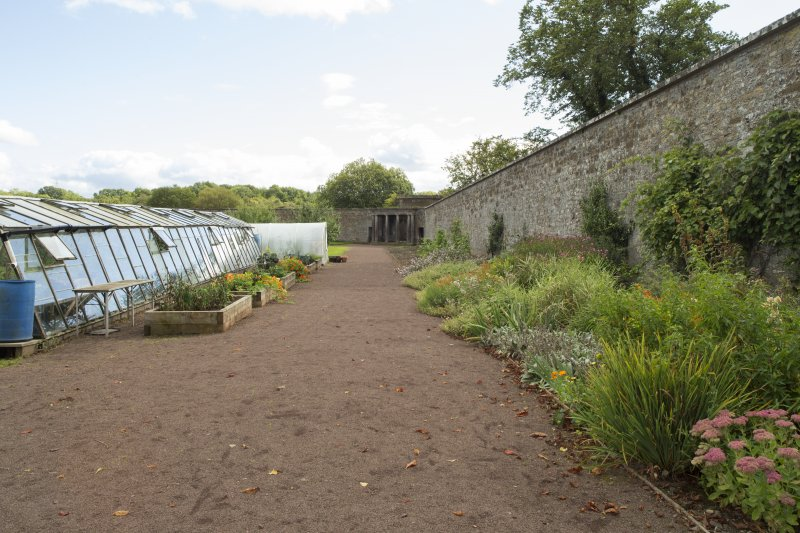 View of west wall and greenhouses.