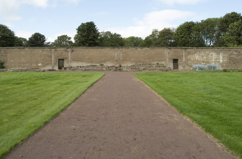 View of north wall and remains of glasshouses.