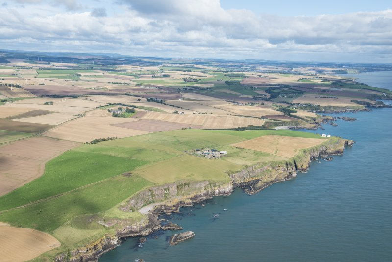 General oblique aerial view of the Aberdeenshire landscape centred on Adam's Castle and Todhead Lighthouse.