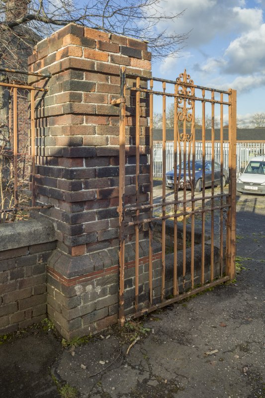 Detail of gate pillar and iron gate at entrance to playground.