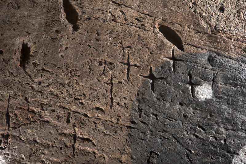 Detail of incised crosses on wall at north side of entrance