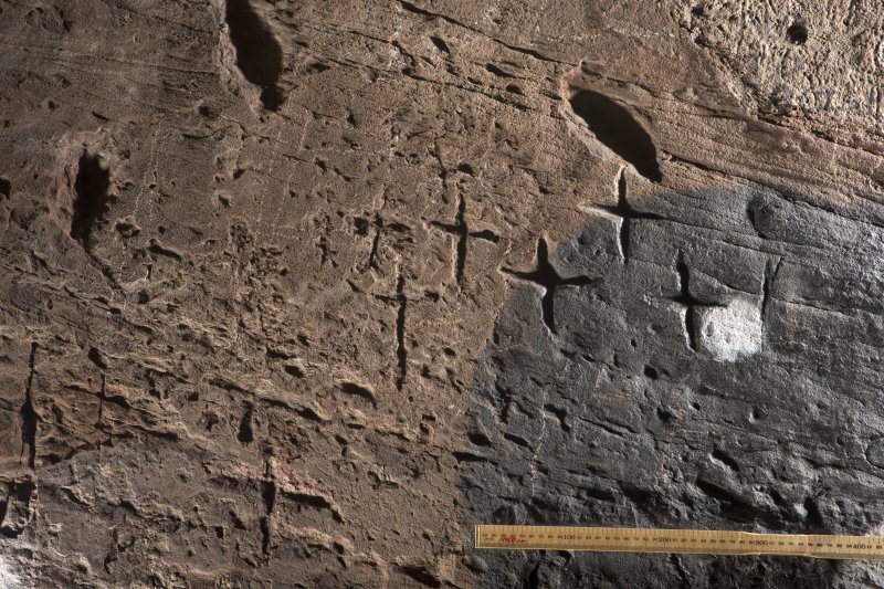 Detail of incised crosses on wall at north side of entrance (including scale)