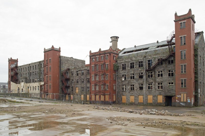 General view from South West of New or North Mill (left), Old Mill (centre) and South Mill (right) with 1920s red brick additions.