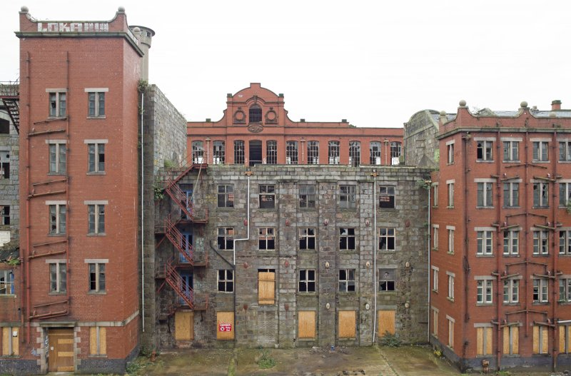 Elevated view of Old Mill (1808, centre) and later (1920s) red brick stairwell and lavatory blocks. The 1914 Red Mill is beyond.