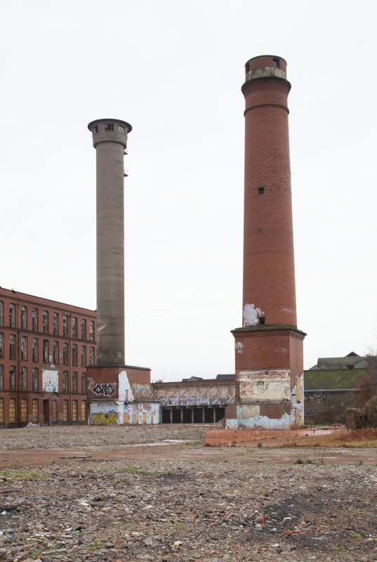 Chimney (right) and later concrete constructed hose drying tower.