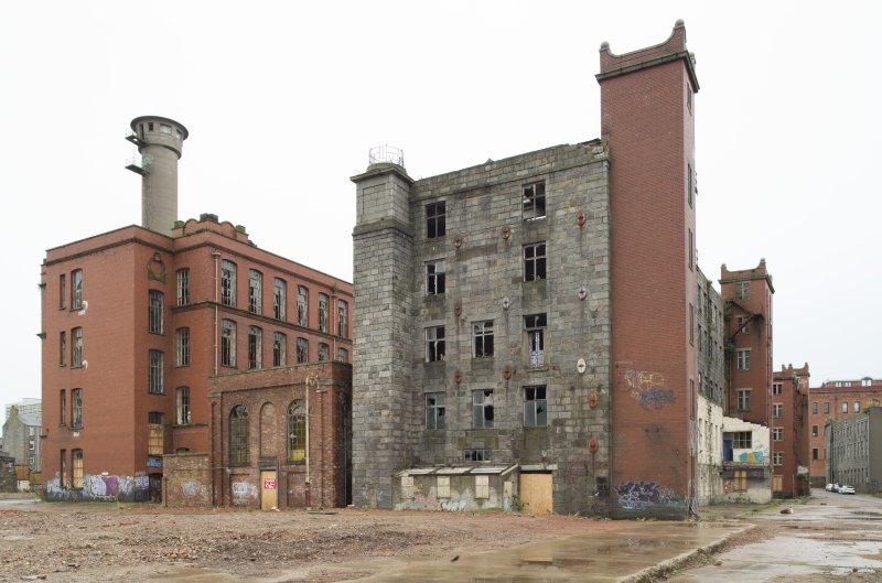 View of north end of North/New Mill (1860s) and the New North and South Mills (1914) with the concrete canvas hose drying tower behind.