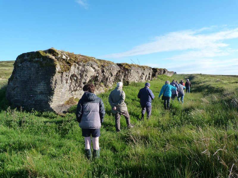 Visitors exploring the trench on the NW side of the Atlantic Wall, Sheriff Muir
