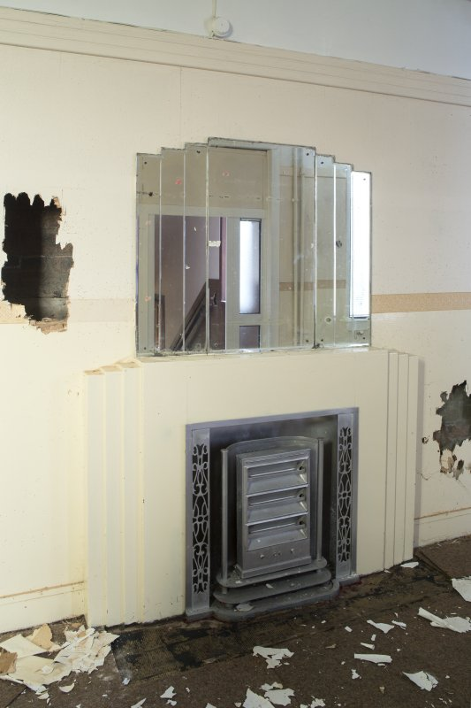 Detail of fireplace and mirror.