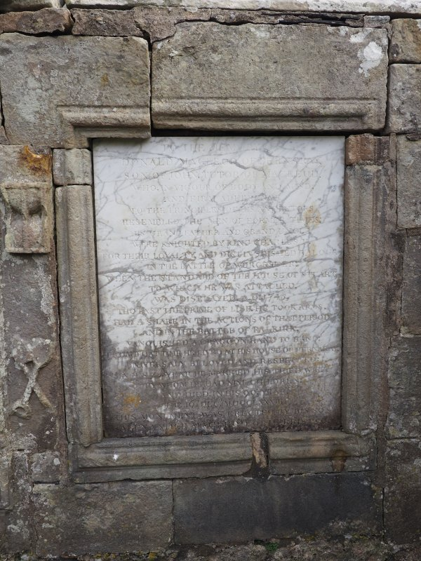 Rodel churchyard. Burial enclosure. Commemorative panel to Donald Macleod of Berneray, erected by his son Alexander Macleod of Harris.