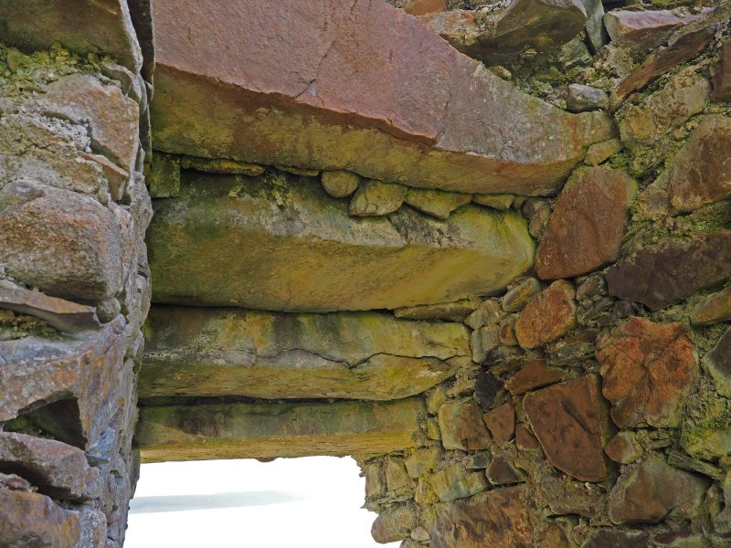 Brochel Castle. Interior. Detail of lintels over entrance passage.