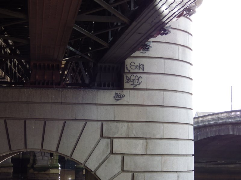 View from N of graffiti on a pier on the west side of the N end of the viaduct.