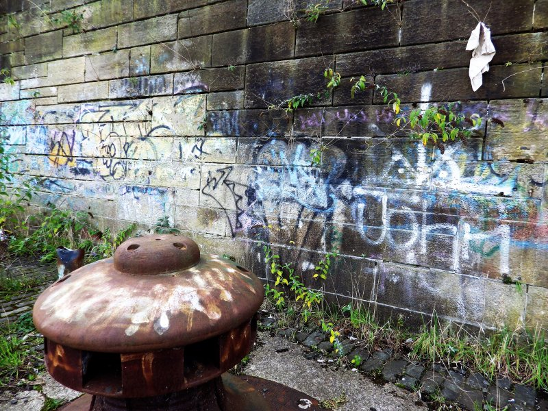 Graffiti on wall and capstan at the west end of the graving docks.