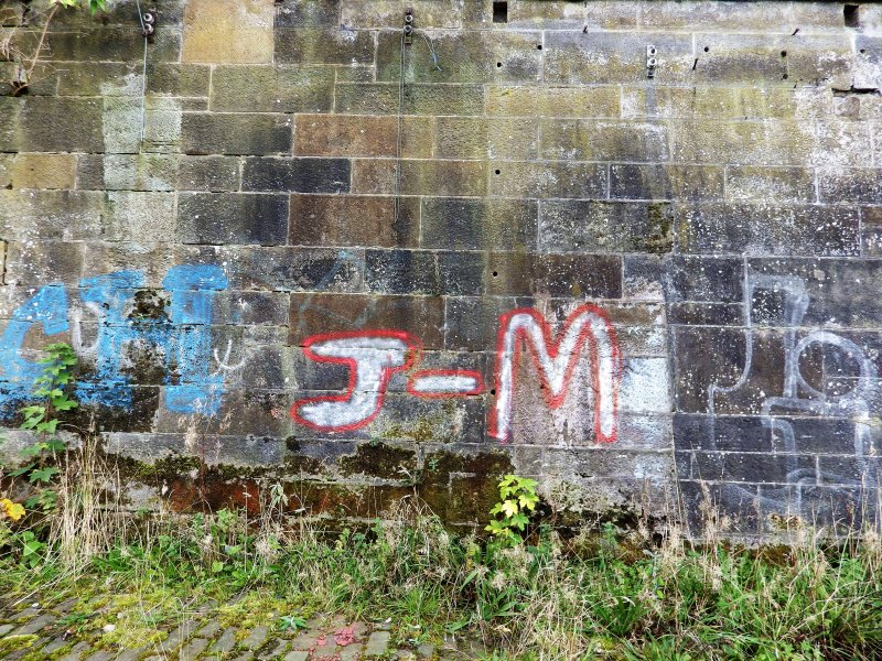 Graffiti on the inner face of the southern boundary wall of the graving docks.