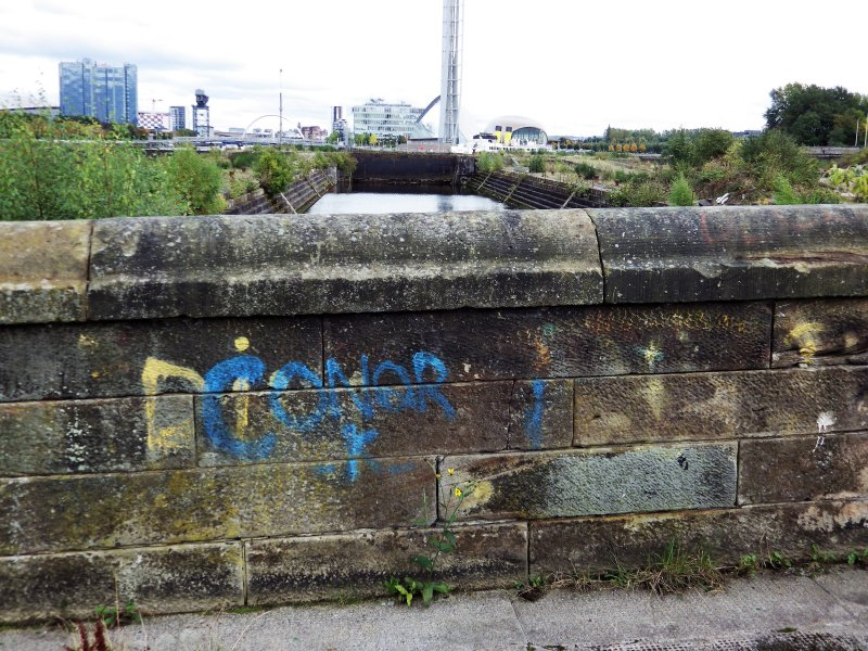 Example of graffiti on the wall to the east of the main access road to the docks.