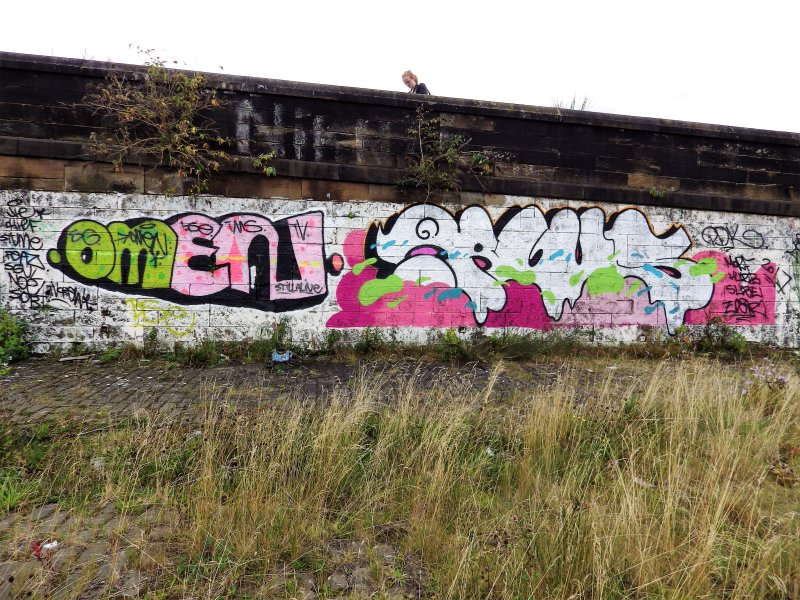 Graffiti on the inner face of the boundary wall on the west side of the dock area.
