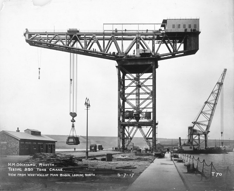 View of testing of 250 tons crane at H M Dockyard, Rosyth, from west wall of main basin looking north.