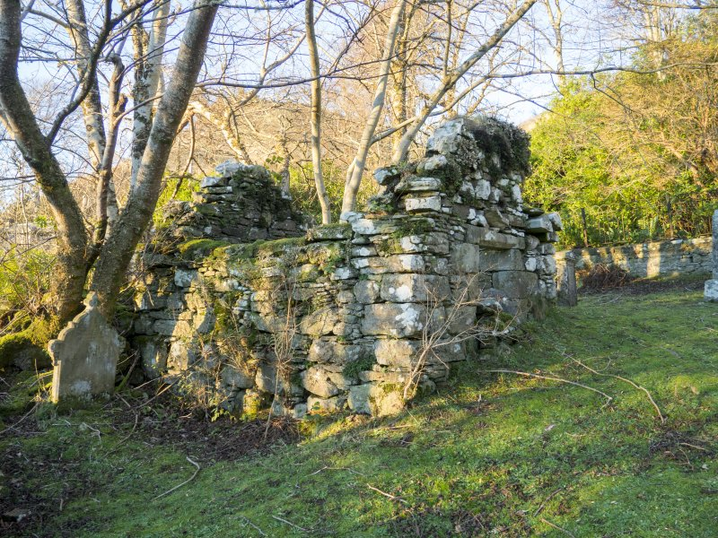 Burial enclosure to W of church