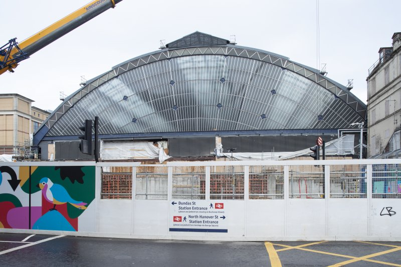 View of exposed tain shed during building work, from south
