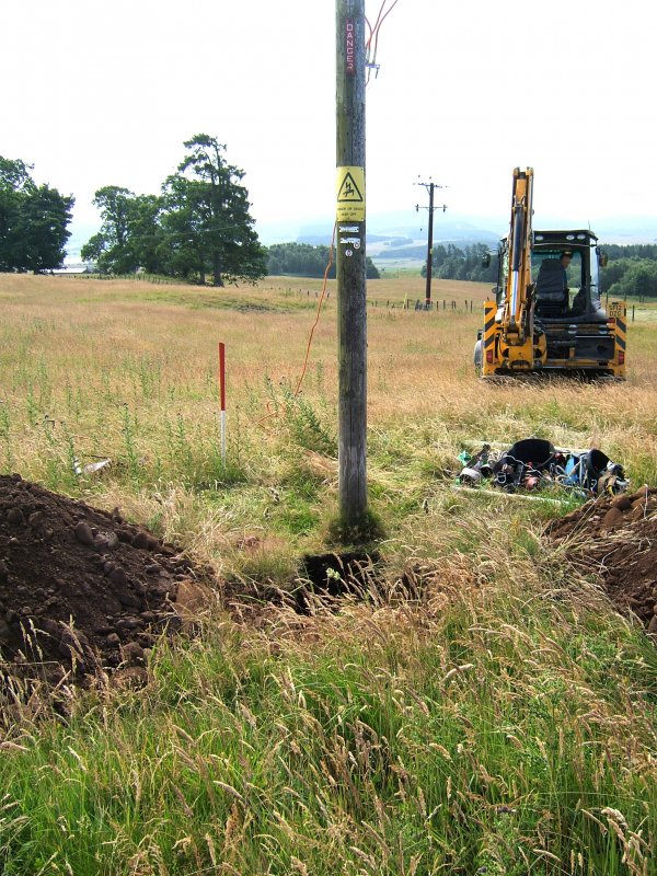 Photograph from watching brief at overhead power line, pole trench and surrounding area, viewed from the NW, at Ardoch Roman Fort Braco, Perthshire