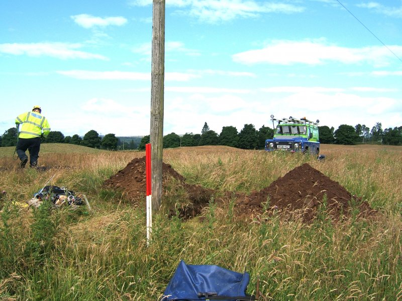 Photograph from watching brief at overhead power line, pole trench and surrounding area, viewed from the E, at Ardoch Roman Fort Braco, Perthshire