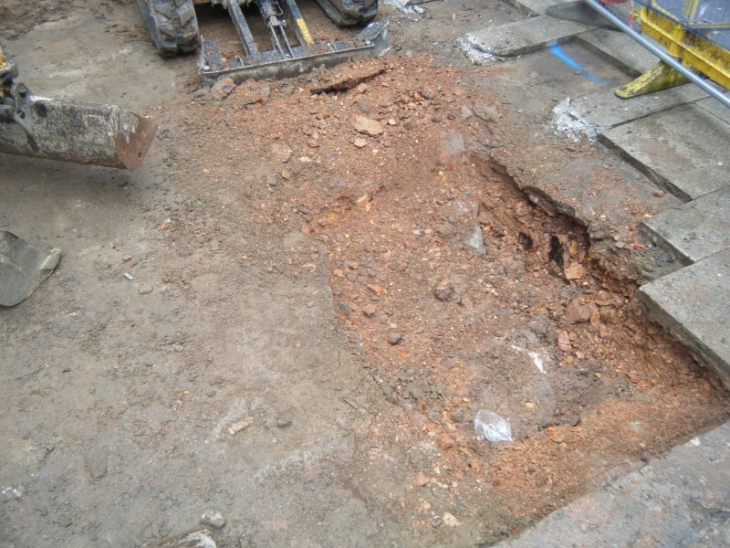 Ph1. Working shot of ground reduction beneath concrete slabs
