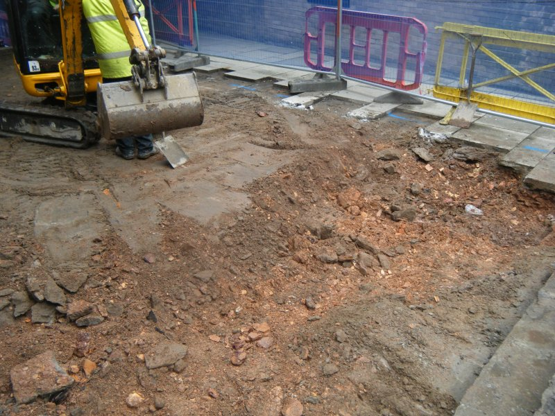 Ph1. Working shot showing sand levelling layer beneath slabs