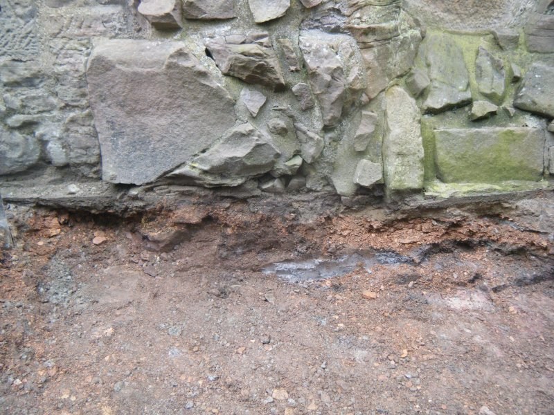 Ph1. Red blaes beneath Merchiston Tower wall supporting stones