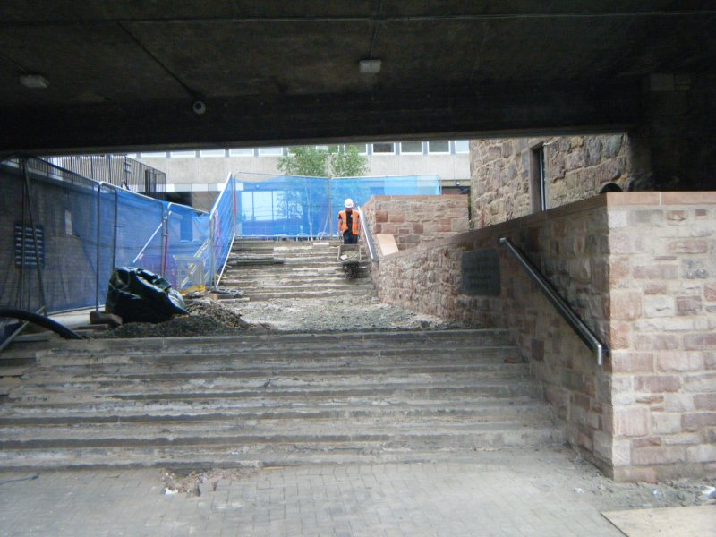 Ph2. Stairs and shelf to be re-surfaced. New wall built during Phase 1 to the right. Phase 2 area between heras fence and outer wall to the left