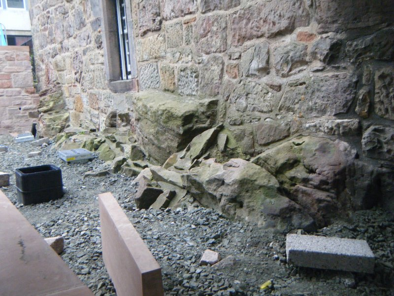 Ph2. East wall of tower built on bedrock. Area excavated and filled with Type 1 gravel during Phase 1.
