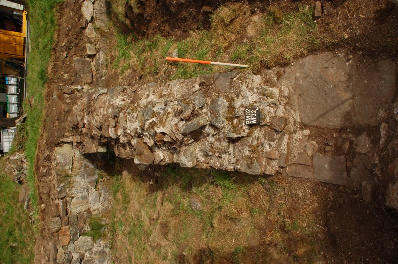 Watching brief photograph, Kindrochit Castle, Wine cellar and Larder dividing wall, deturfed wallhead (WF 32)