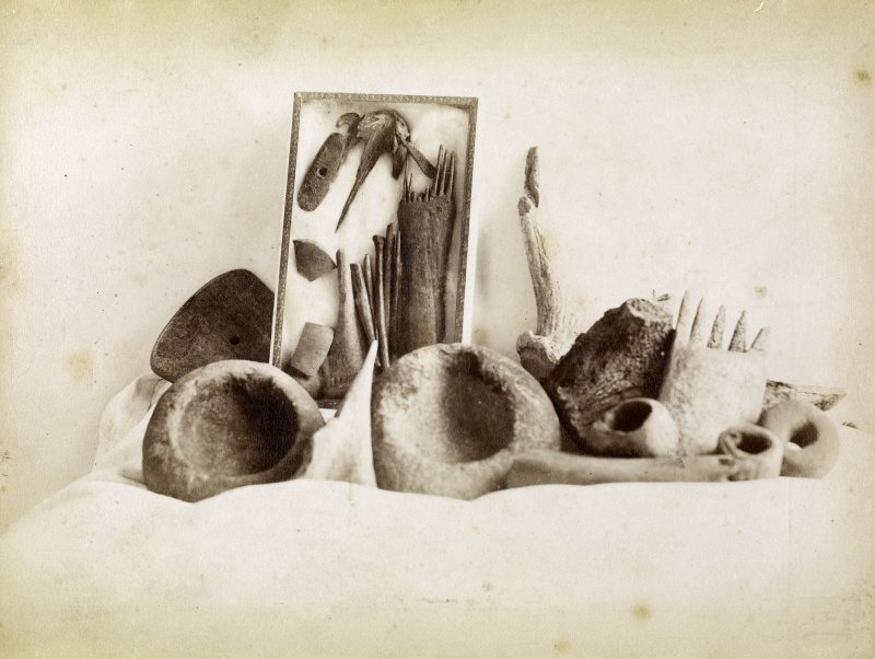 Photograph from Caithness Brochs album. Collection of finds from Keiss Broch.