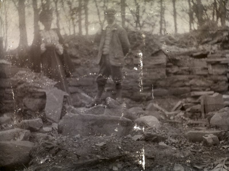 Photograph of a man and woman standing inside Hill of Works (Barrock) broch.