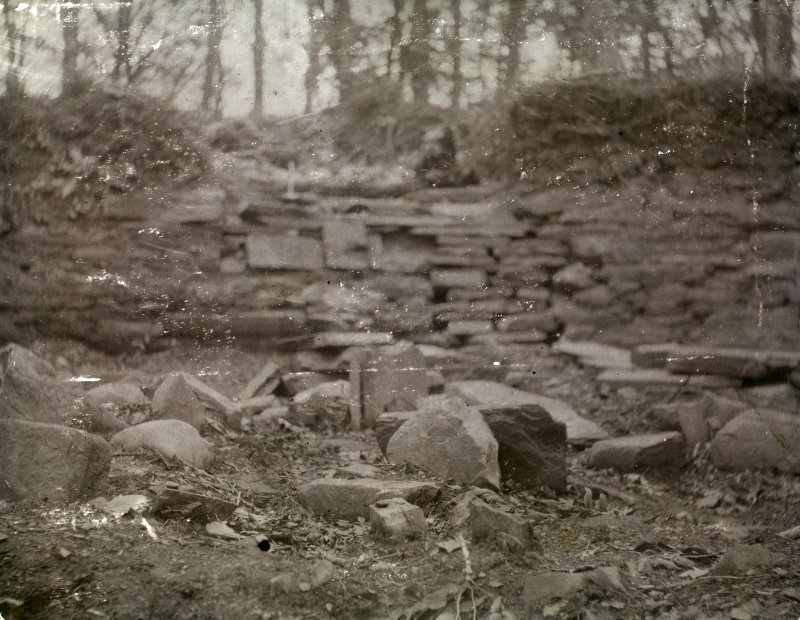 Photograph of Hill of Works (Barrock) broch. Slabs in the interior.
