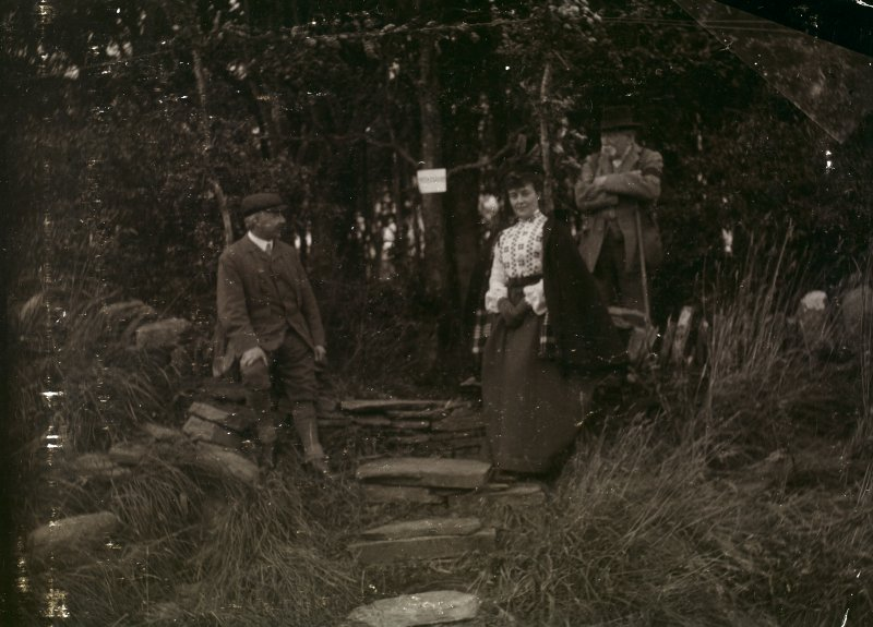 Photograph of Sir Francis Tress Barry, a man and a woman at Hill of Works (Barrock) broch.