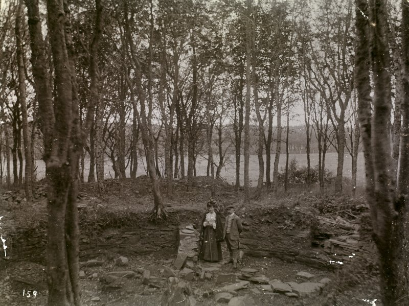 Photograph of man and woman at Hill of Works (Barrock) broch.