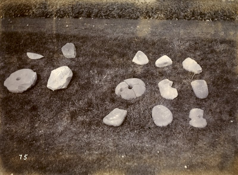 Photograph showing collection of querns excavated at Keiss White Broch and Keiss Wester Broch.