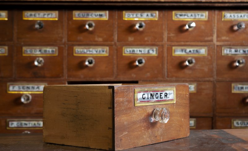 Coldstream, 81 High Street. Interior. Pharmacists medicine drawer. Detail showing 'GINGER' drawer label (painted and gilded glass).
