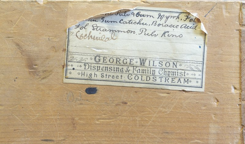 Coldstream, 81 High Street. Interior. Pharmacists medicine drawer. Detail showing drawer label on back of drawer for 'George Wilson', former chemist.