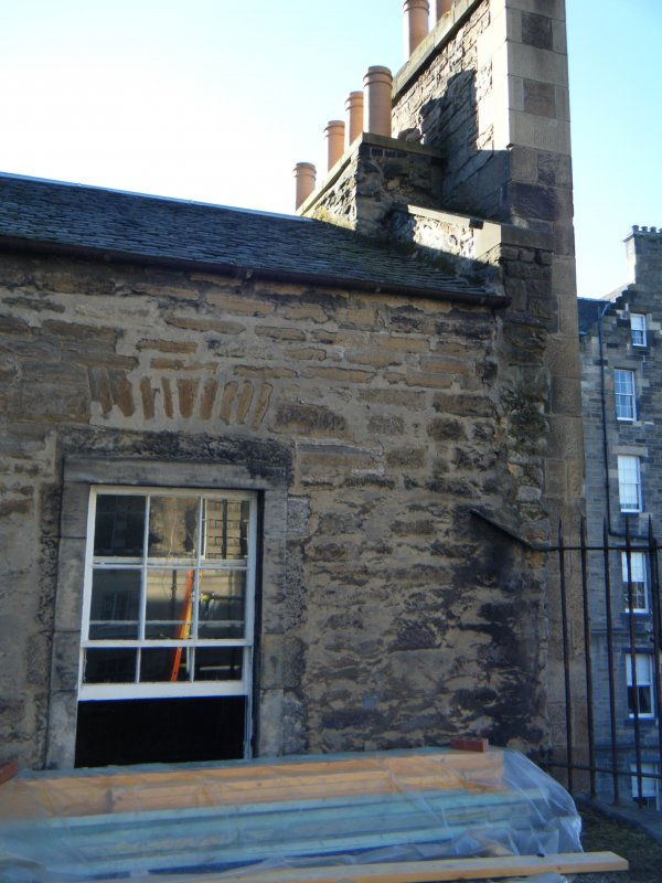 Standing building recording, Exterior wall with window opening, 343 High Street, Edinburgh