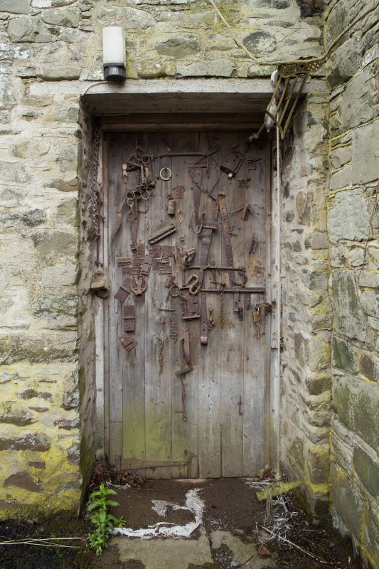 Detail of workroom door with retrieved garden implements at The Steading, Nether Blainslie.