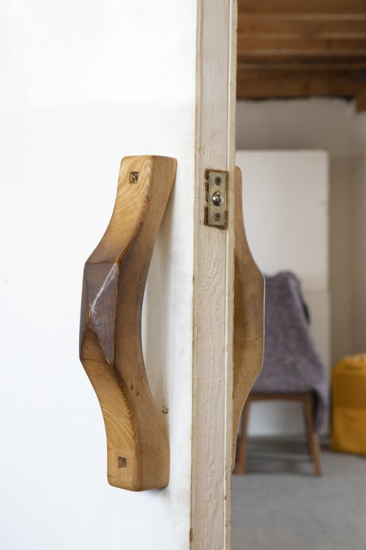 Interior view showing detail of door handles to varnishing room in stables workshop at The Steading, Nether Blainslie.